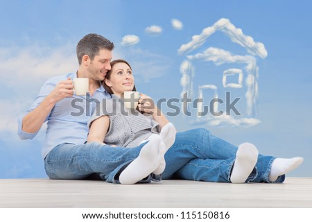family parents dreaming of new home - stock photo