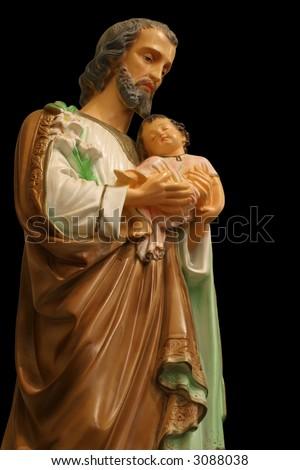 Family Patron Saint - Statue of Saint Joseph holding the infant Jesus. - stock photo