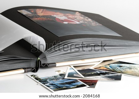 Family Photo Album with wooden covers - stock photo