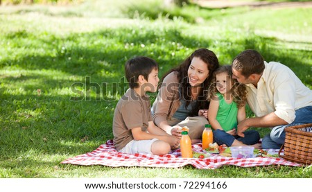 Family  picnicking together - stock photo