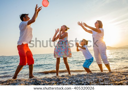 Family play on beach