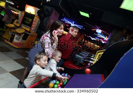 Family playing at the indoor amusement park - stock photo
