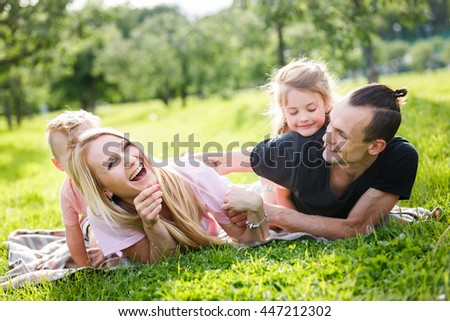 Family playing in the park