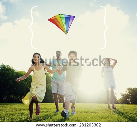 Family Playing Kite Summer Outdoors Leisure Concept
