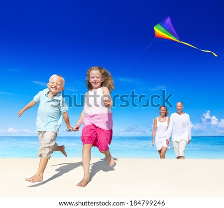 Family playing on the beach. - stock photo