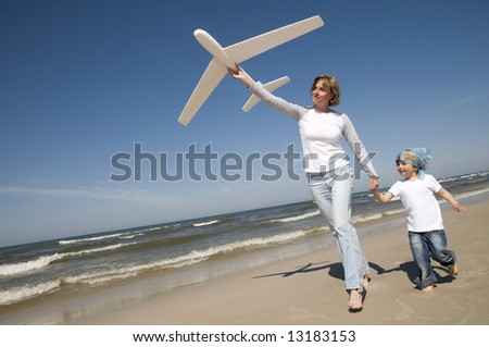 Family playing with plane model - stock photo