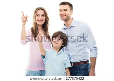 Family pointing up  - stock photo