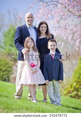 Family portrait during spring with selective focus on children - stock photo