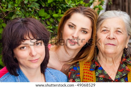Family portrait - happy daughter granddaughter and grandmother - stock photo