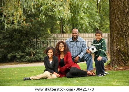 Family portrait in yard - stock photo