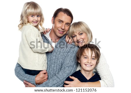 Family portrait of a couple with their two children. Isolated over white. - stock photo