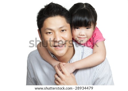 Family portrait of young Chinese father piggybacking little daughter dressed in pink. Shot in studio, isolated in white - stock photo