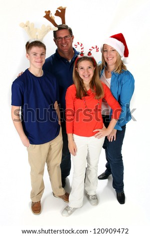Family posing for Christmas photo wearing festive holiday hats