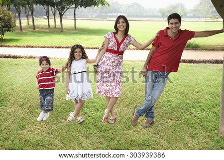 Family posing in a park - stock photo