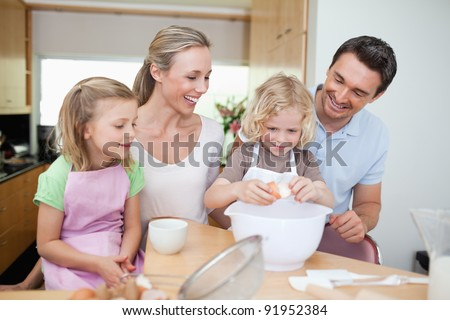 Family preparing cookies together - stock photo