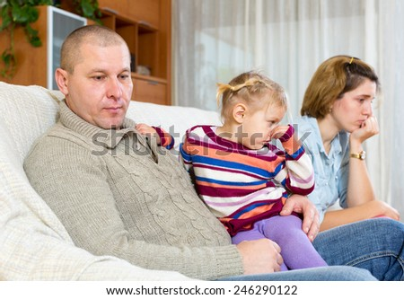 Family quarrel. Angry adult man against and unhappy young woman