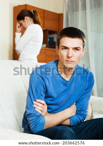Family quarrel. Depressed man listening to woman at home