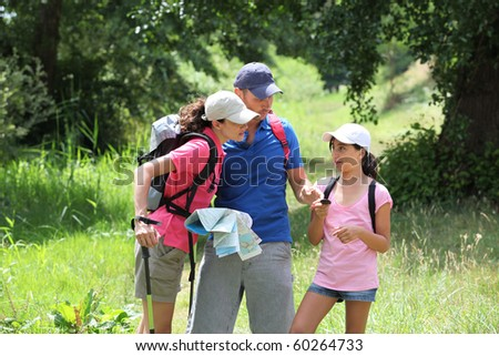 Family rambling in the countryside - stock photo