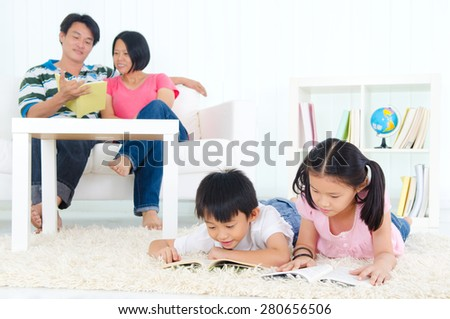 Family reading - stock photo