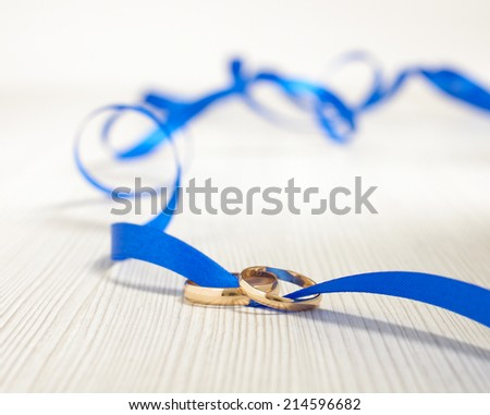 Family relationship concept two rings tied together - stock photo