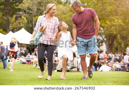 Family Relaxing At Outdoor Summer Event - stock photo