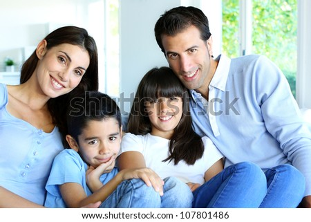 Family relaxing in sofa at home - stock photo