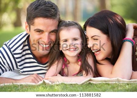 Family Relaxing In Summer Garden - stock photo