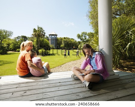 Family Relaxing Outdoors - stock photo