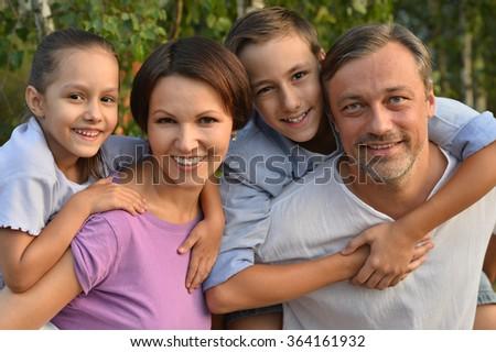 Family resting in  summer park - stock photo
