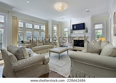 Family room in luxury home with fireplace - stock photo