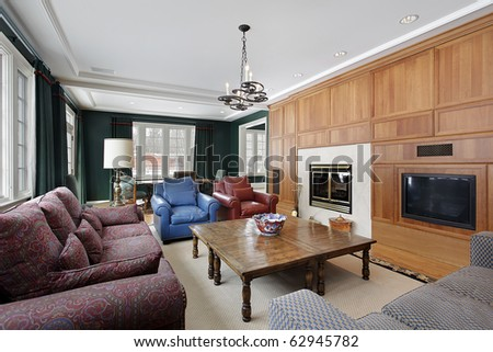 Family room in luxury home with wood paneled cabinetry - stock photo