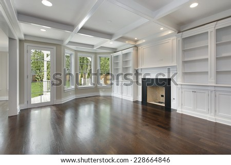 Family room in new construction home with fireplace - stock photo