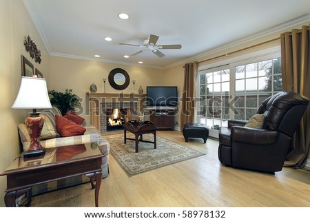 Family room with fireplace and doors to patio - stock photo