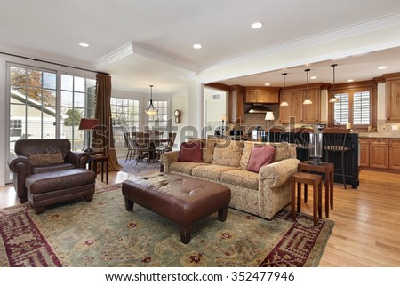 Family room with view into kitchen and breakfast area - stock photo