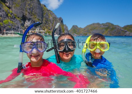 Family scuba diving - stock photo