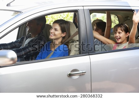 Family Setting Off On Car Journey - stock photo