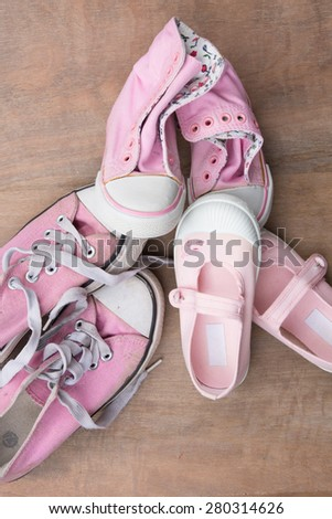 Family shoes on wooden background, family concept - stock photo