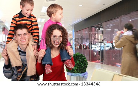 family shoppers in store - stock photo