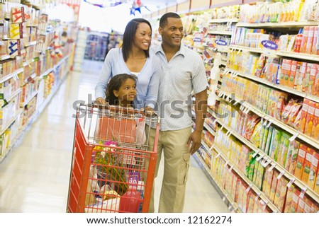 Family shopping for groceries in supermarket - stock photo