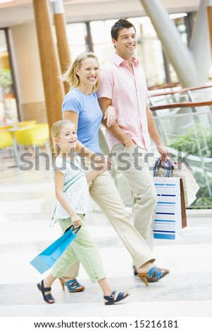 Family shopping in mall carrying mall - stock photo