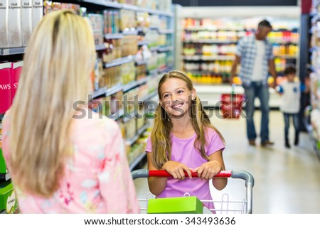 Family shopping together in the supermarket - stock photo