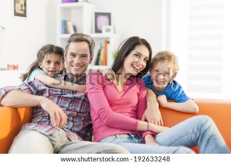 Family Sitting On Sofa Her Living Stock Photo (Edit Now)- Shutterstock