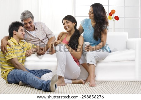Family sitting together in the living room