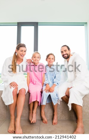 Family sitting together on bathtub