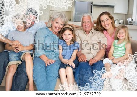Family spending leisure time against snowflake frame - stock photo