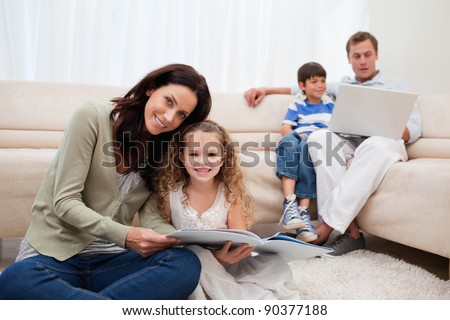 Family spending leisure time in the living room together - stock photo
