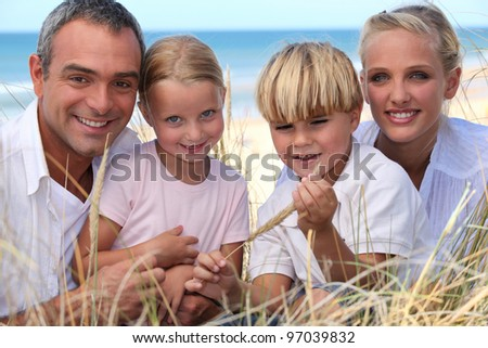Family spending the day by the seaside - stock photo