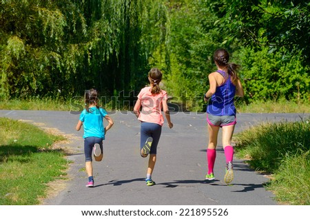 Family sport, mother and kids jogging outdoors, running in park  - stock photo