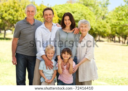 Family standing in the park - stock photo