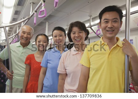 Family standing in the subway, portrait